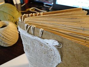 linking threads sewn around boards by spine