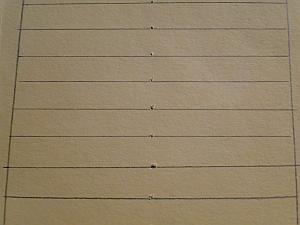 lines ruled across prick marks
