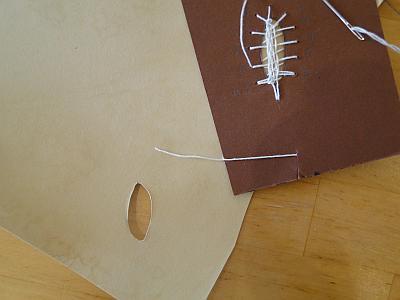 stitching around hole in parchment
